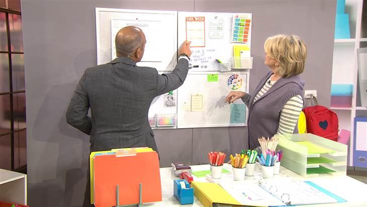 "Matt Lauer and Martha Stewart showcasing her ""wall of organization."""