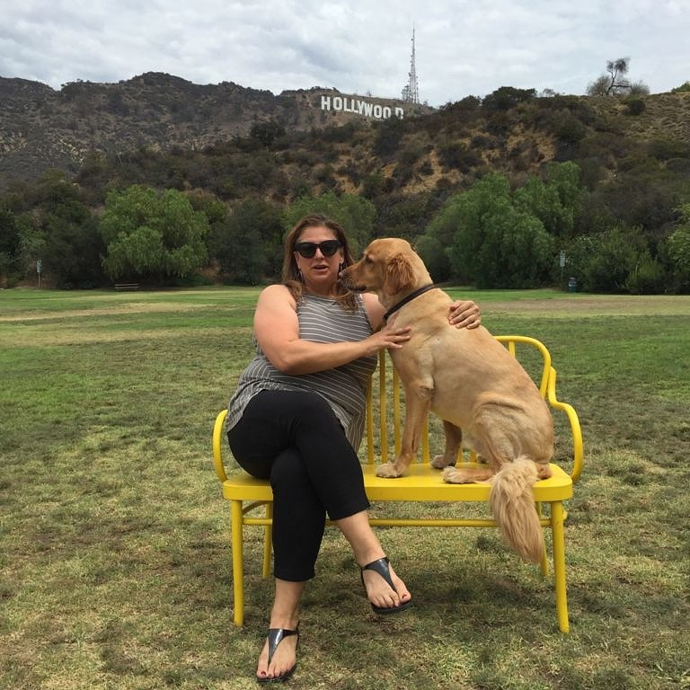 Author Jen Bilik and dog Paco in front of the Hollywood sign
